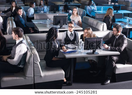 Business conference and presentation. Audience at the modern conference hall. - stock photo