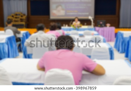 Business Conference meeting Presentation  in hall  and white projector slide screen Blur blurred view from back