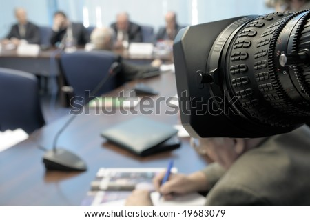 Business Conference under the lens. - stock photo