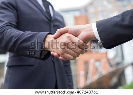 Business confidence. Close up of handshake of two successful business partners. Outdoors business concept