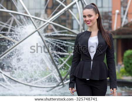 Business confidence. Portrait of motivated business woman. Successful woman in formal wear at work. Outdoors business concept.