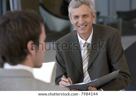Business consultant taking notes - stock photo