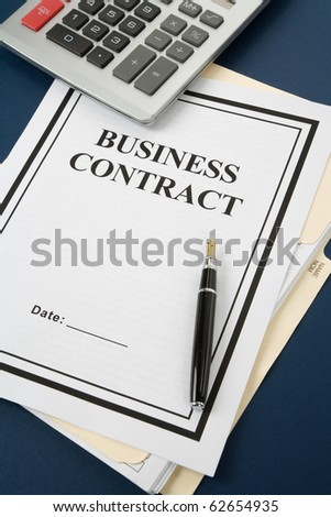 Business Contract and calculator close up