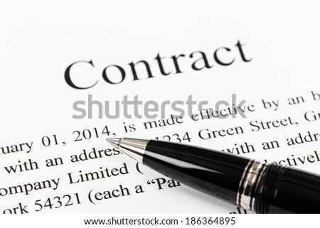 Business contract document focus on pen