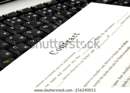 Business contract on PC - stock photo