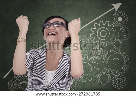 Business control concept: Successful businesswoman controlling her business to growth - stock photo