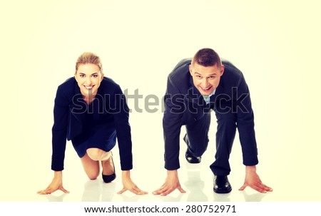 Business couple compete between each other - stock photo