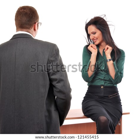 Business couple flirting at job. Boss courting with female secretary in the office.