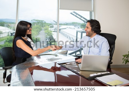 Business couple greeting each other - stock photo