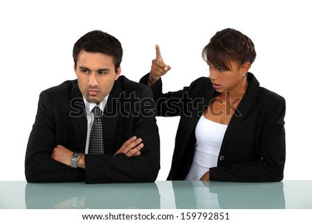 Business couple having a quarrel - stock photo