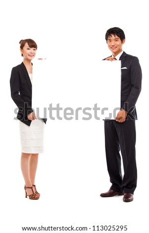 Business couple holding a add banner.