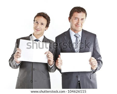 Business couple holding blank signs - stock photo