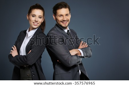 Business couple on blue background - stock photo