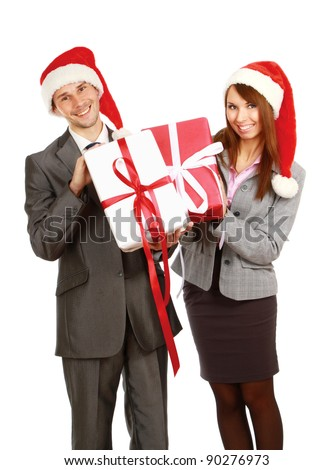 Business couple on santa hat  with the gift. Isolated at white background