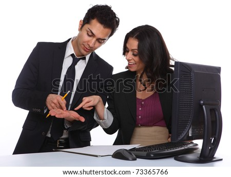 Business couple solving a problem in the office - stock photo