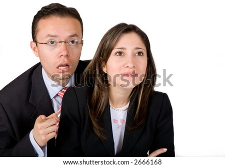 business couple surprised about something they are looking at on the screen
