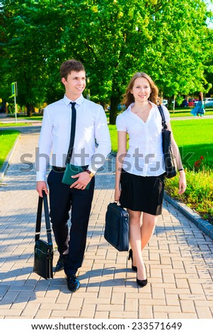 Business couple walking down the street and talking
