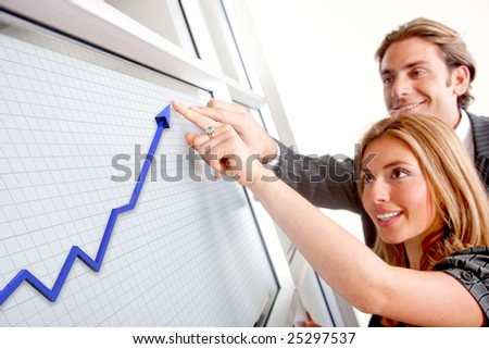 Business couple with a graph - Business success - stock photo