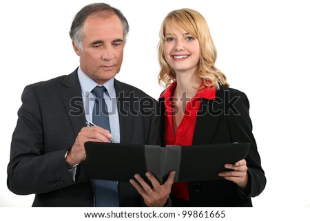 Business couple with a planner - stock photo
