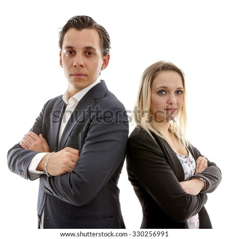 Business couple with arms crossed over white background