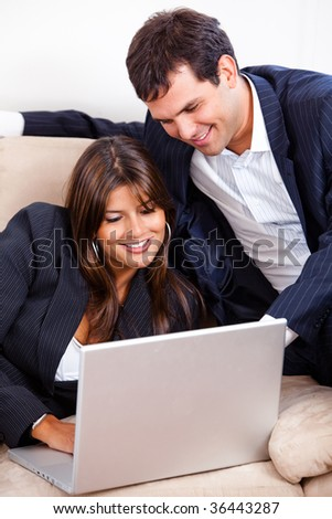 Business couple working on a laptop computer