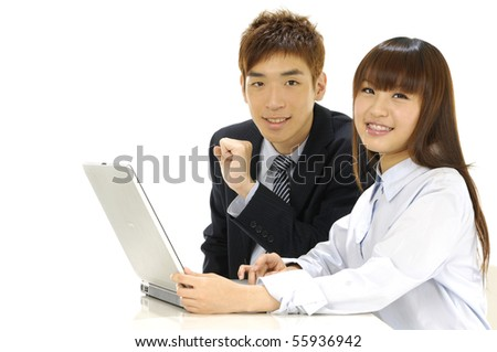 Business couple working on laptop - stock photo