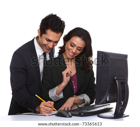 Business couple working with computer isolated on white - stock photo