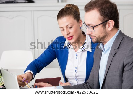 Business coworkers analyzing business document - stock photo