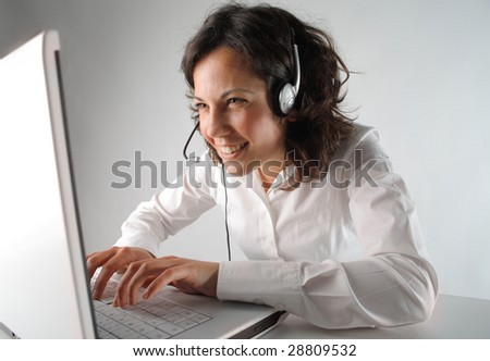 business customer support operator woman smiling - stock photo