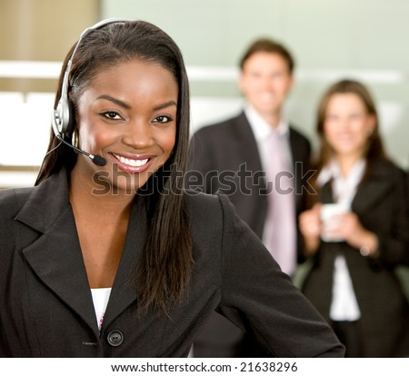 business customer support operator woman smiling in an office - stock photo