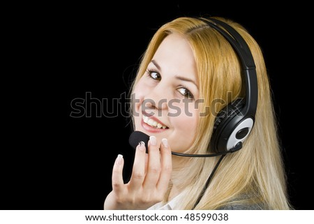 business customer support operator woman smiling - isolated in black - stock photo