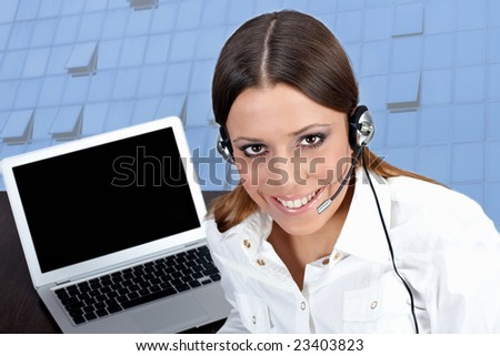 Business customer support operator woman with laptop in background.