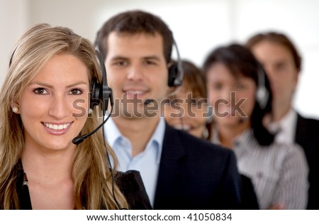 business customer support team in an office with headsets - stock photo