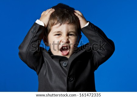 Business, cute little boy portrait over blue chroma background - stock photo