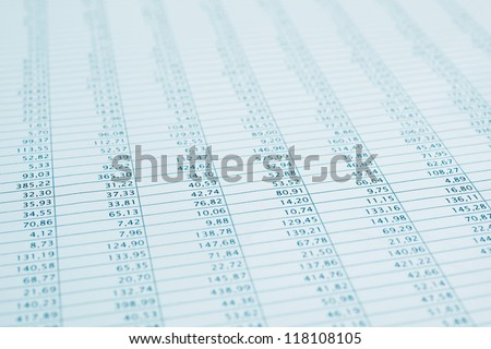 Business data report selective focus close up. Monthly stock stats spreadsheet. Blue toned. - stock photo