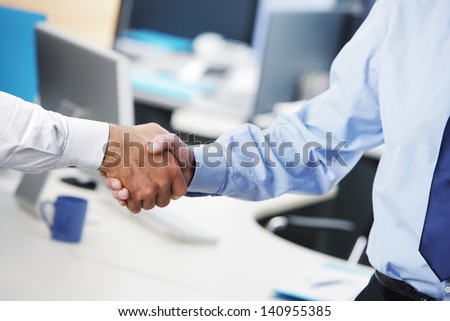 Business deal. Close up of a handshake - stock photo