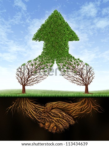 Business deal growth and team partnership with the roots of two trees  in the shape of a human hand shake and the empty branches succeeding as a healthy green upward arrow on a summer sky. - stock photo