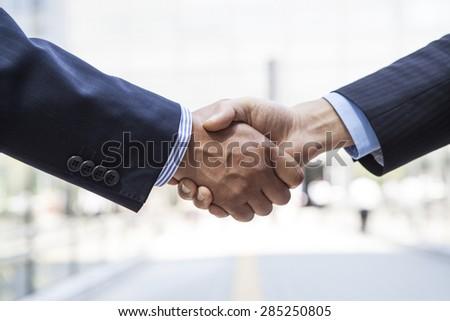 Business deal, handshake - stock photo