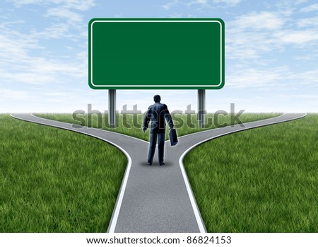 Business decision with a business man at a cross roads and road sign with blank green signage showing a fork in the road representing the concept of planning and strategy in a career and finance. - stock photo