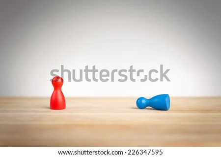 Business defeat or bowing to the king concept with game pieces on white - stock photo