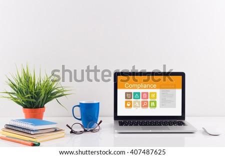 Business desk concept - Compliance - stock photo