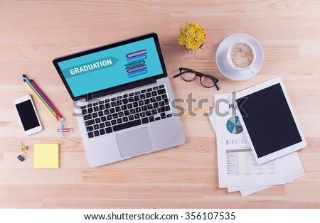 Business desk concept - GRADUATION - stock photo
