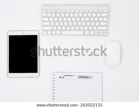 Business desk with a keyboard, mouse and pen on white table - stock photo