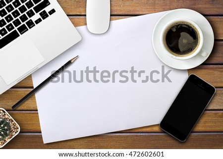 business desk with a keyboard, mouse and pen on wooden table with space for text. over light