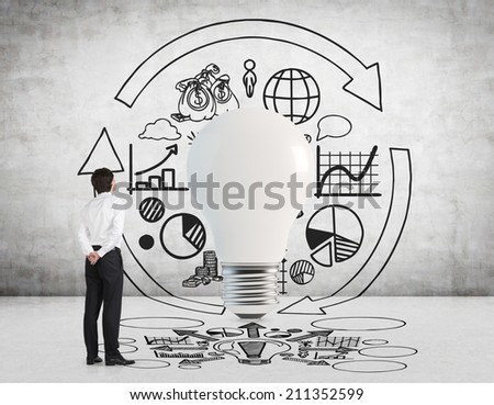 Business development concept, light bulb as a symbol of the new idea and different stages of business development. Businessman and the business forecast. - stock photo