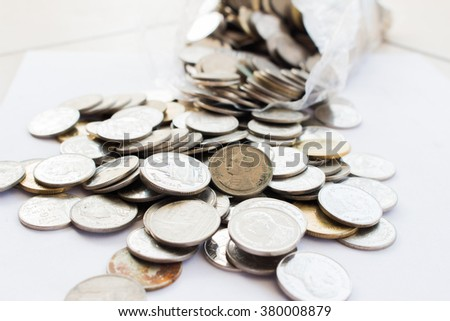Business diagram on financial report with coins art background - stock photo