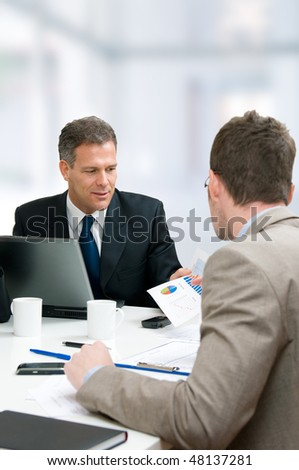 Business discussion at working meeting in office, vertical copy space - stock photo