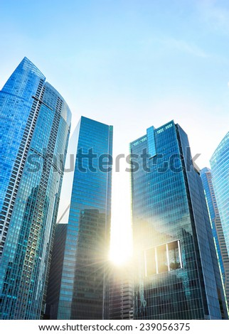 Business district of Singapore at sunset - stock photo