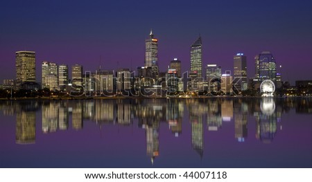 Business district with stunning reflection - stock photo