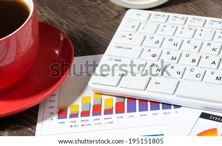 business documents, keyboard and cup of coffee. workplace businessman - stock photo
